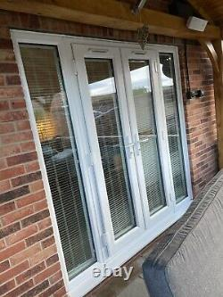 Exterior external Upvc double glazed French Doors in frame and side Windows