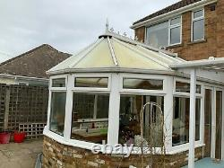 Large white Victorian style conservatory, frames. Windows, french doors, roof