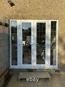 UPVC French door and frame with side windows. White Lead Pattern And Window Seen