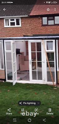 UPVC White Patio French Doors in frame with side panels & windows 270w x 229h