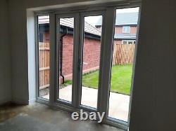 White upvc double Glazed french doors in frame with Side Windows 3 months old